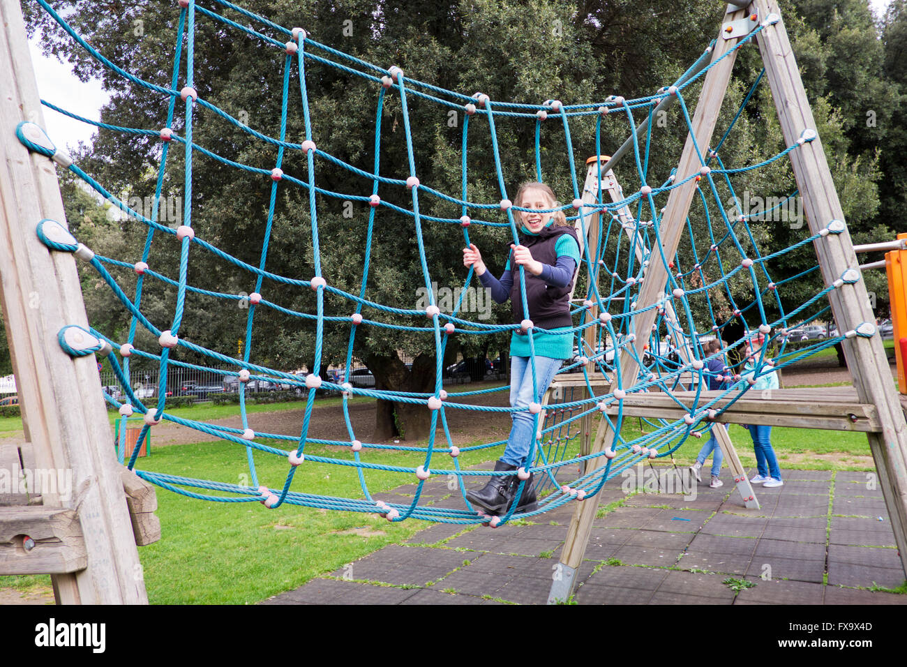 pre teen girl playing in park games in Frascati in italy - Stock Image
