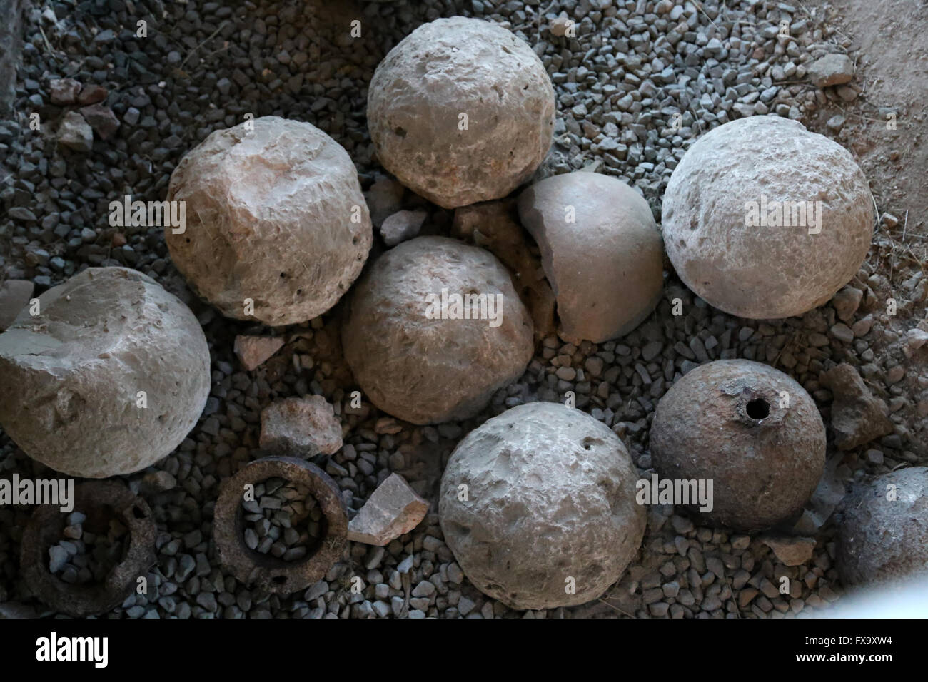 Bombard balls. Stones and iron. Burgos. The Castle. Warehouse of the Museum of Burgos. - Stock Image