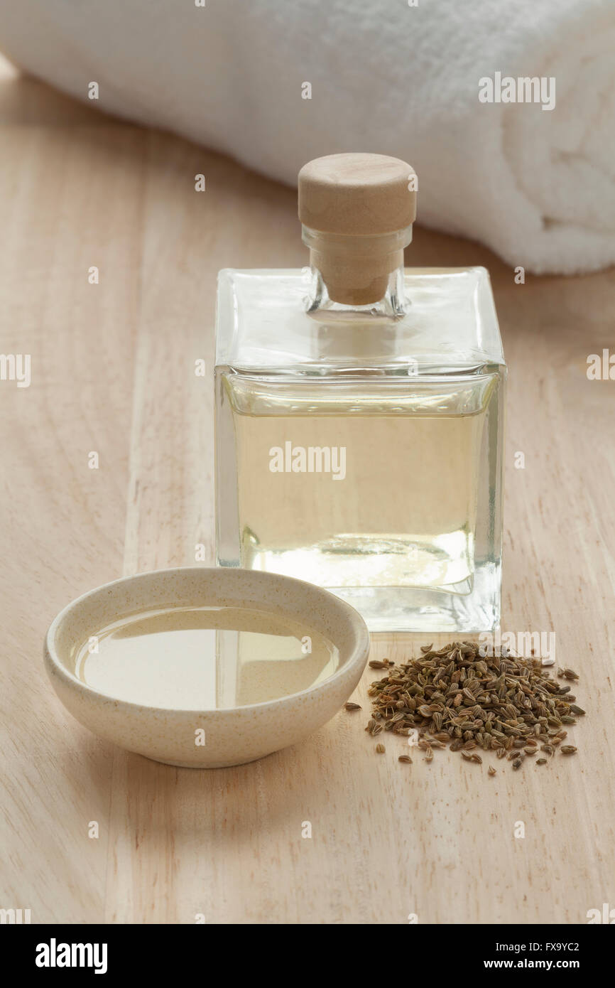 Bottle with anise oil and seeds for aroma therapy - Stock Image