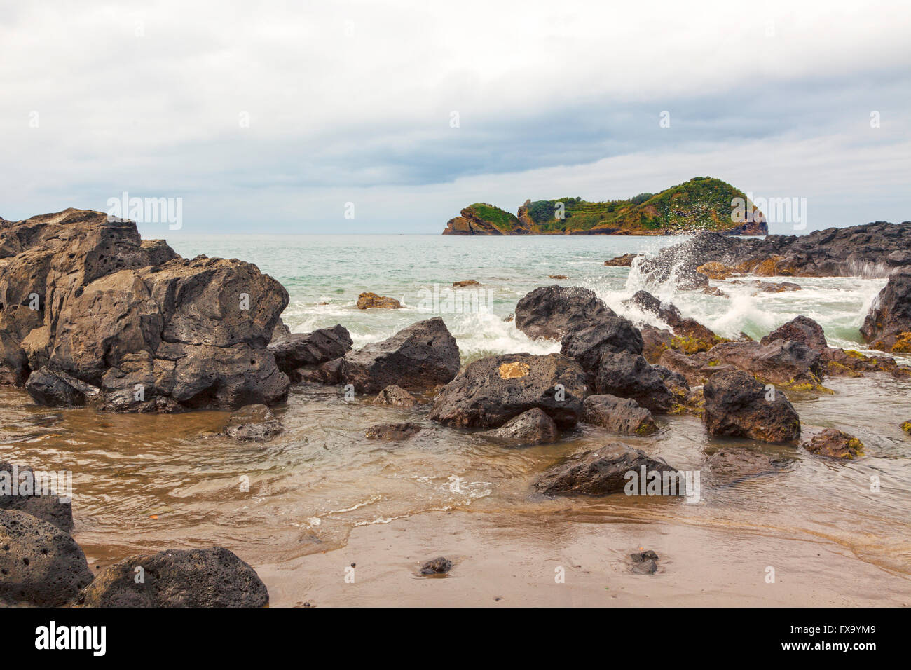 Ilheu de Vila Franca and rocky coast of Sao Miguel island - Stock Image