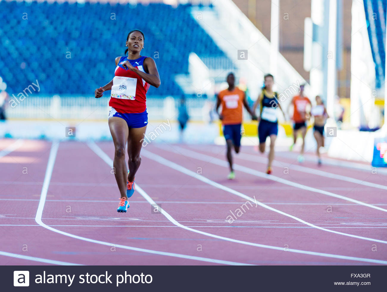 Ormara Durand Cuban paralympic athlete easily winning her race.Athletics competition and medals ceremonies during - Stock Image