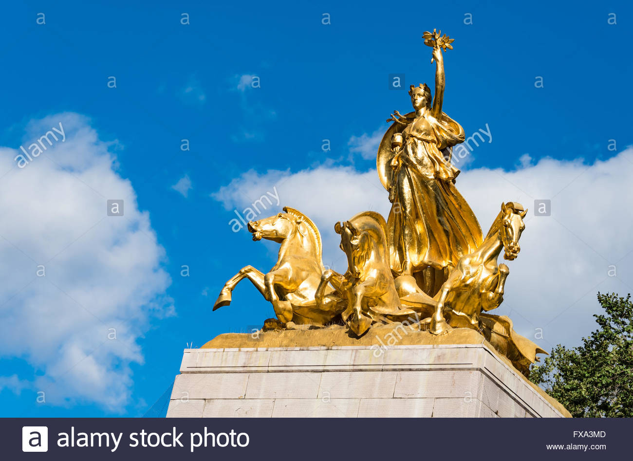 Golden munument at Columbos Circle: landmark visited by many tourists and locals Stock Photo