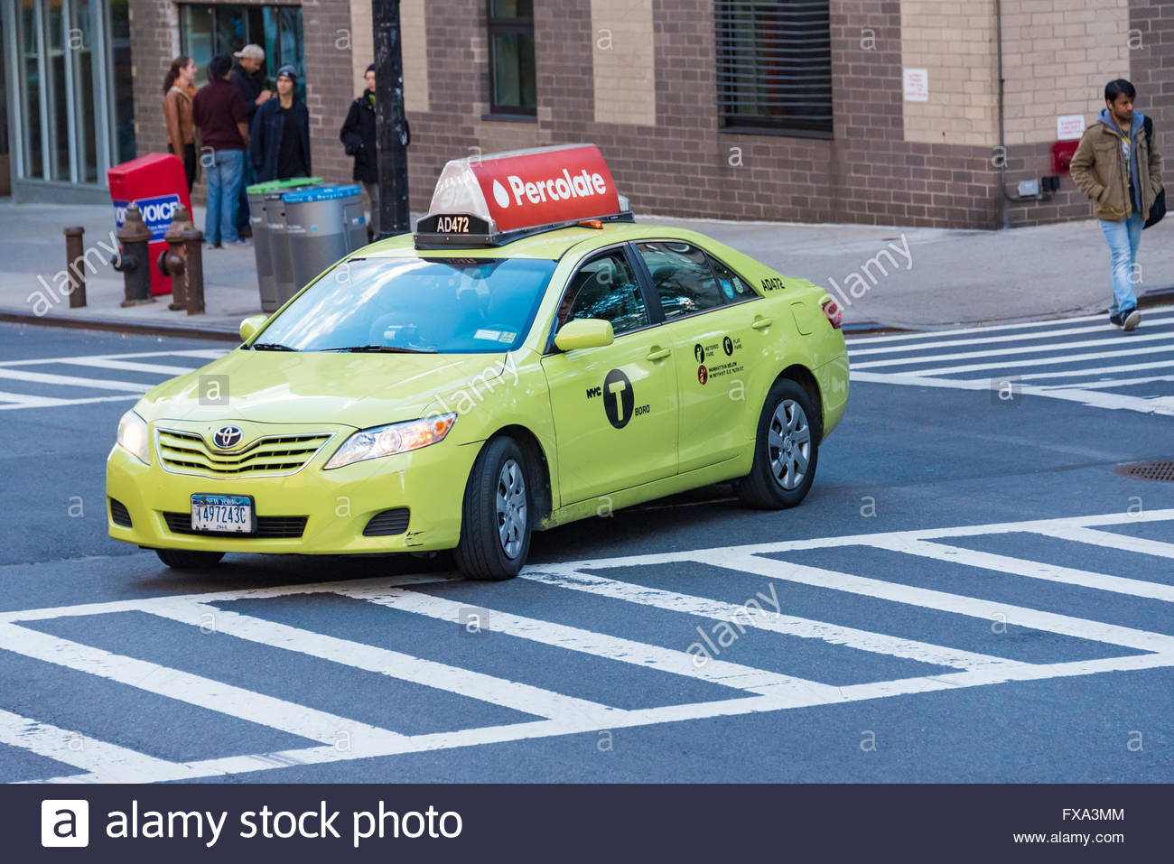 New York City: Toyota green taxi cab making a turn on a busy
