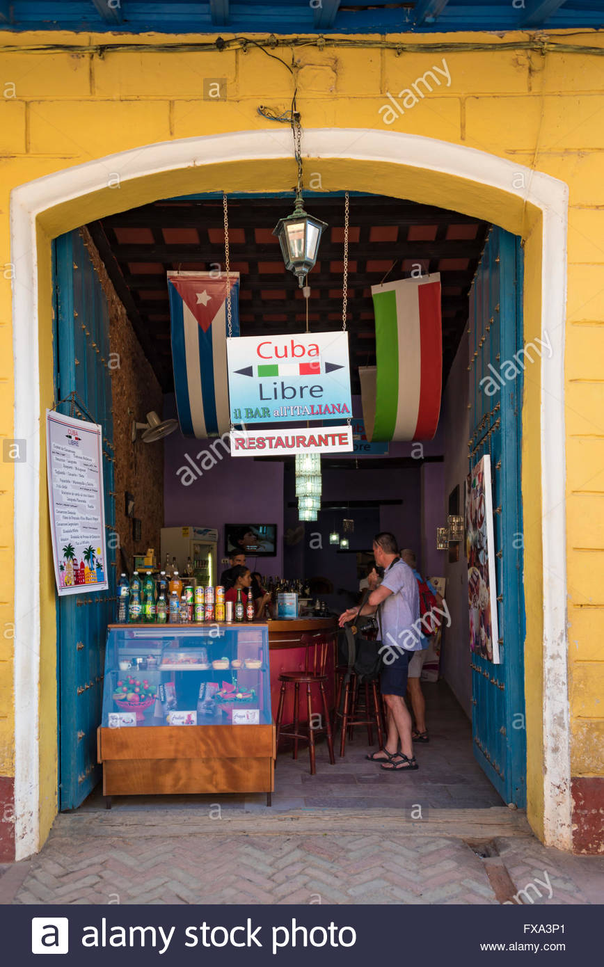 Tourists entering Cuba libre restaurant: Local restaurant found in Trinidad city - Stock Image