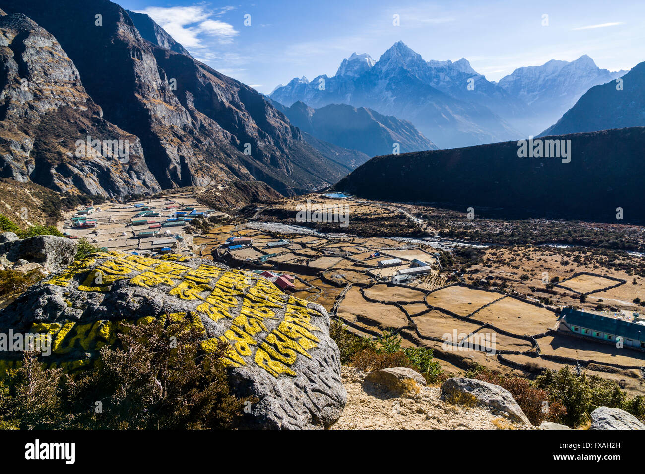 View of the agricultural village of Thame, snow covered mountains in the distance, Thame, Solo Khumbu, Nepal - Stock Image