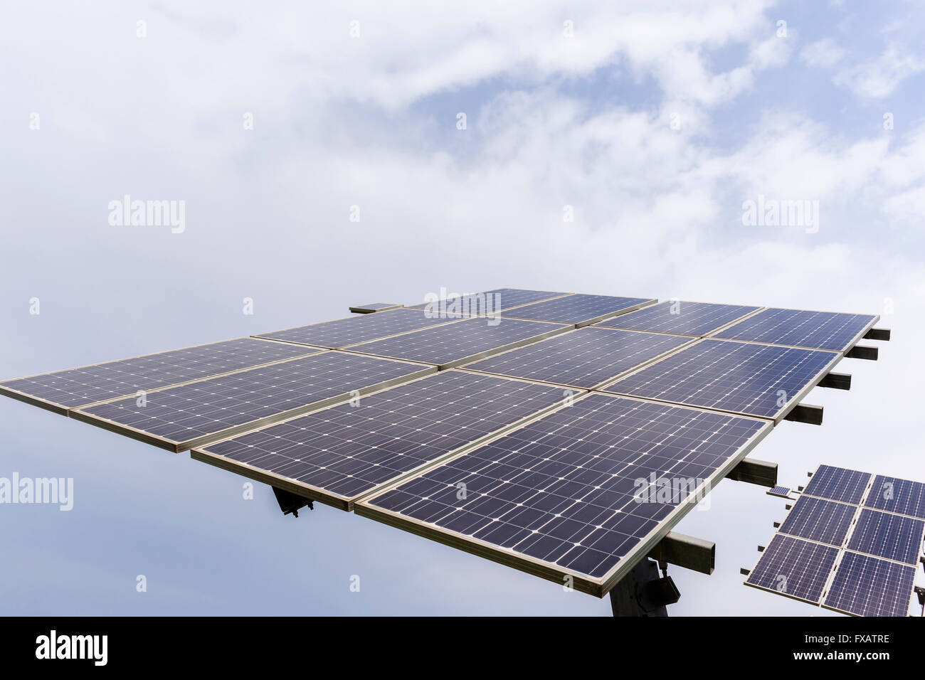 Solar screen panels creating clean electricity outdoors facing north closeup photo of technology structures. - Stock Image