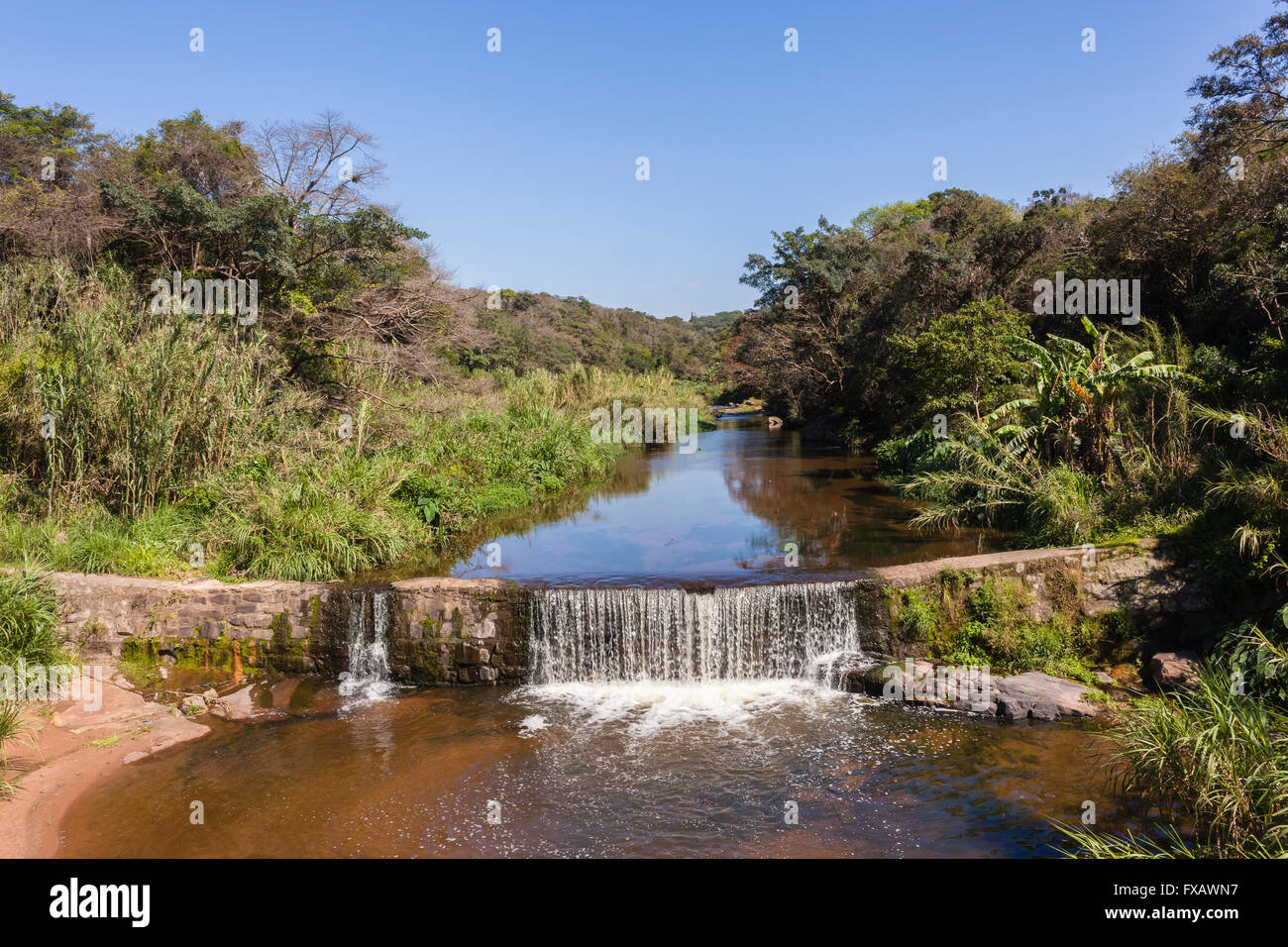 River small waterfall wall weir summer countryside overlooking photo - Stock Image