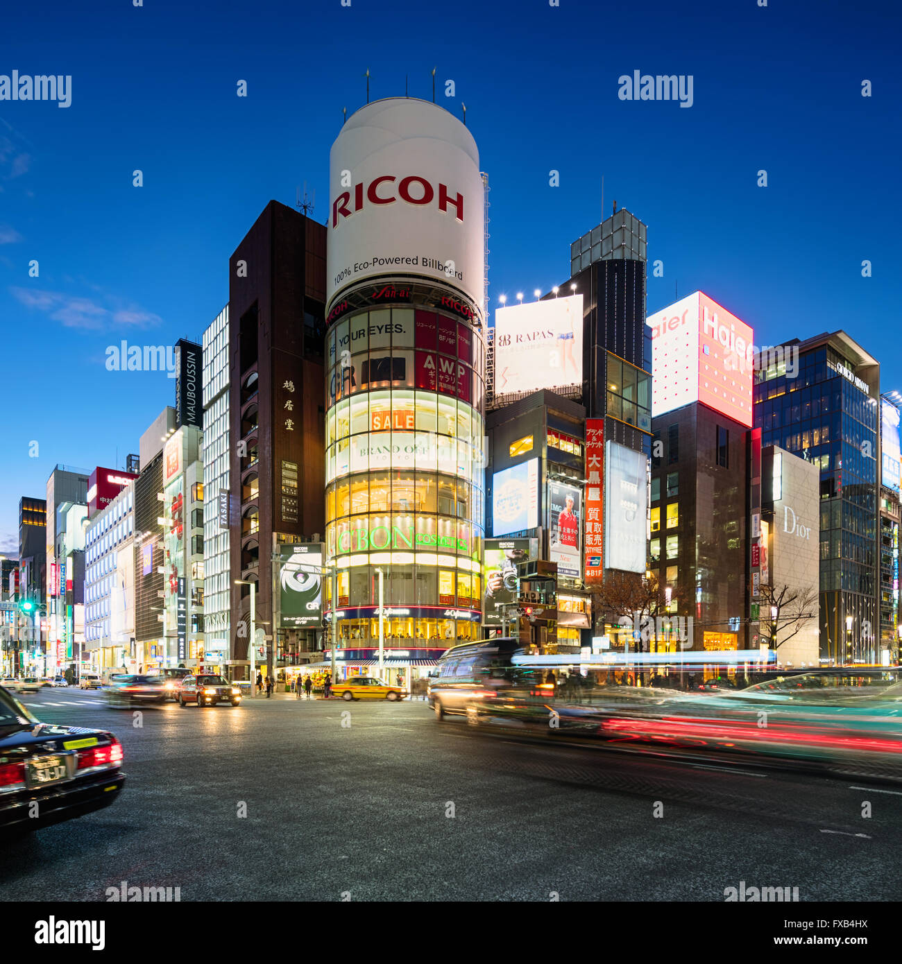 Tokyo, Japan - January 18, 2015: Ginza shopping district at rush hour in Tokyo. The iconic Sanaa Building is at Stock Photo