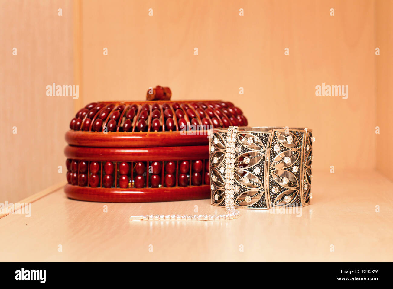 Handmade women's jewelry box with necklaces and metal bracelets - Stock Image
