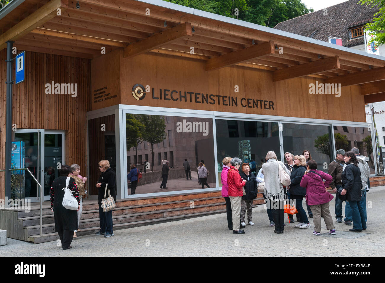 Group of tourists near The Liechtenstein Center -official tourist office in Vaduz, Liechtenstein, Europe - Stock Image