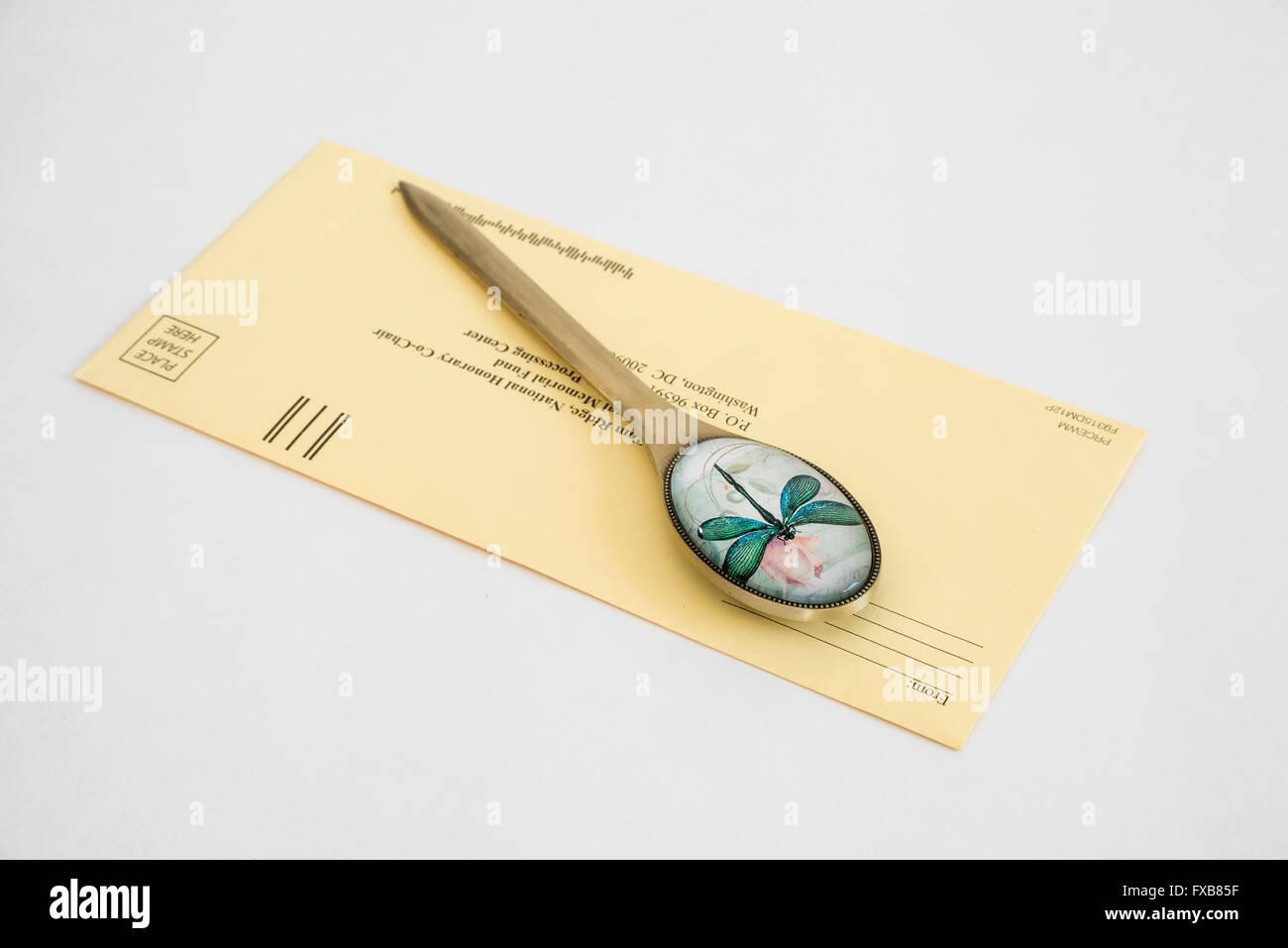 Stylish Letter Envelope Opener Knife  with Floral Designed Handle, Office Desk Accessories - Stock Image