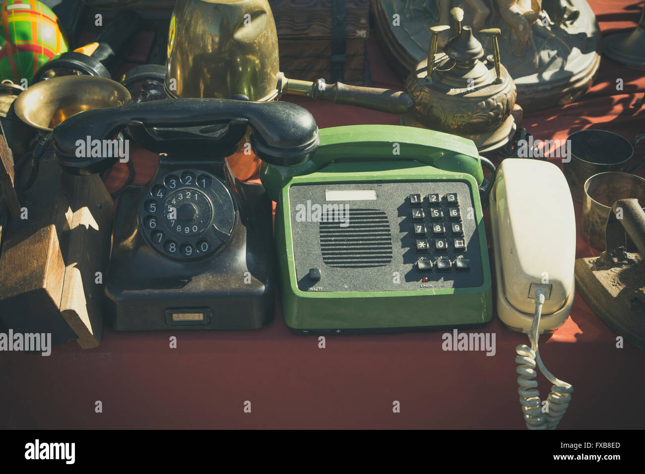 Old telephones in a jumble sale - Stock Image