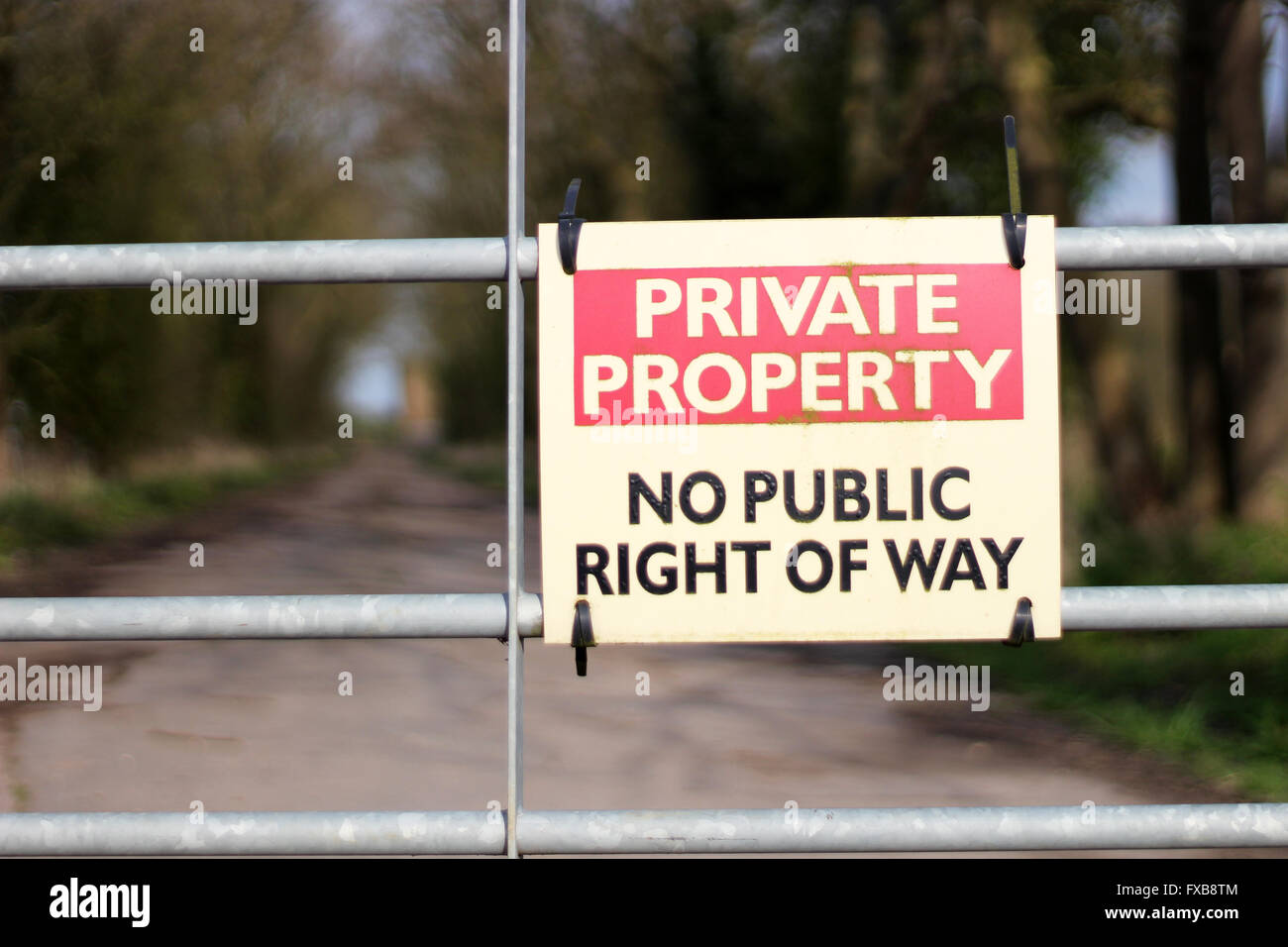 An old private property sign not allowing entry onto owners land Stock Photo