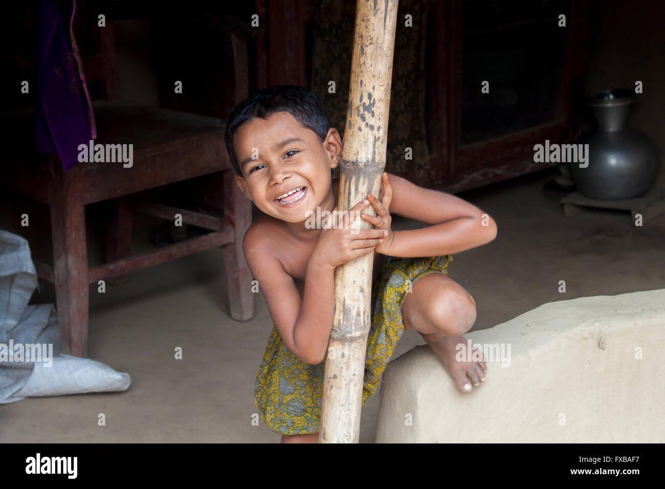 A little girl smiling in the Vola District, Barishal, Bangladesh, Asia © Jahangir Alam Onuchcha/Alamy - Stock Image