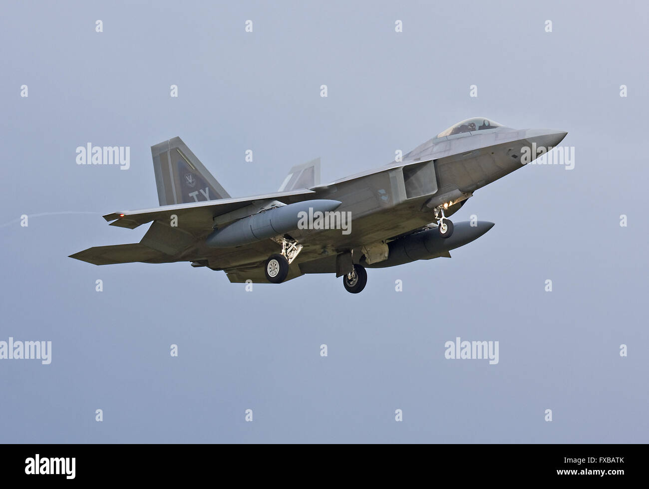 Tyndall AFB based USAF F-22 Raptor landing at RAF Lakenheath, England - Stock Image