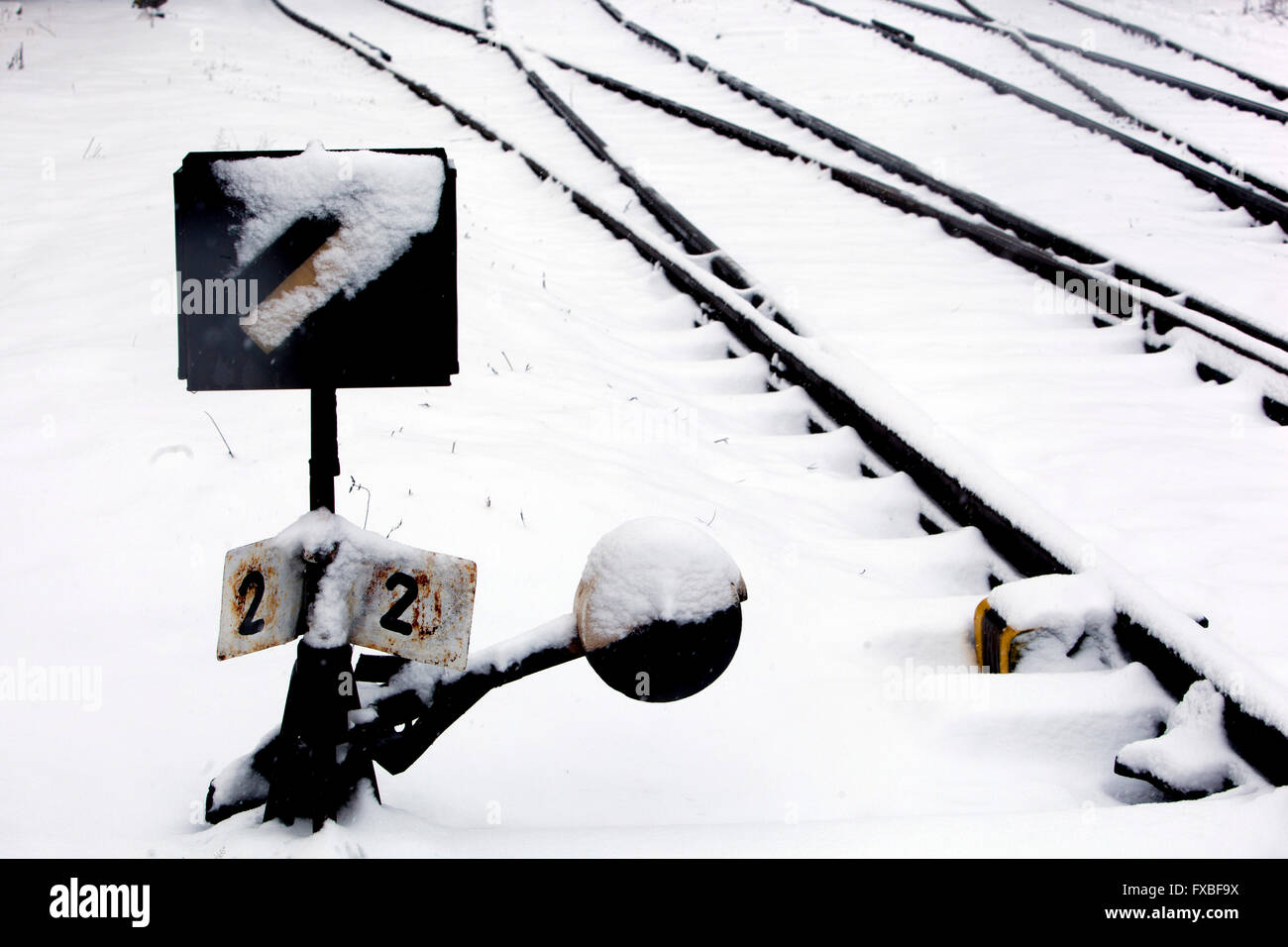 snowy railway track and turnout, Czech Republic - Stock Image