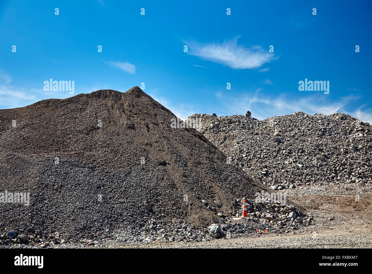 construction jobsite excavation grading gravel and rock piles for sitework - Stock Image