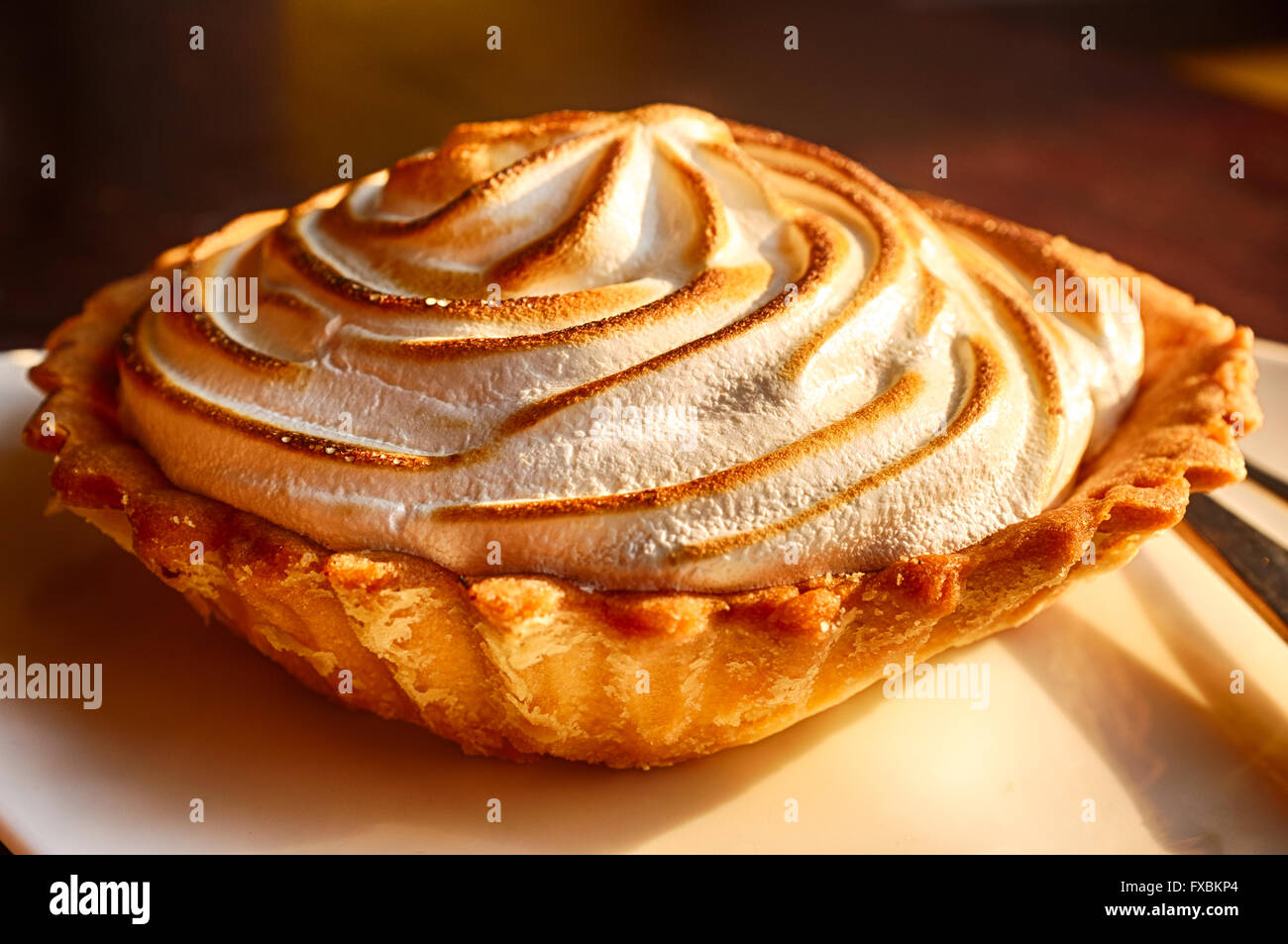 Close up shot of a lemon meringue pie - Stock Image
