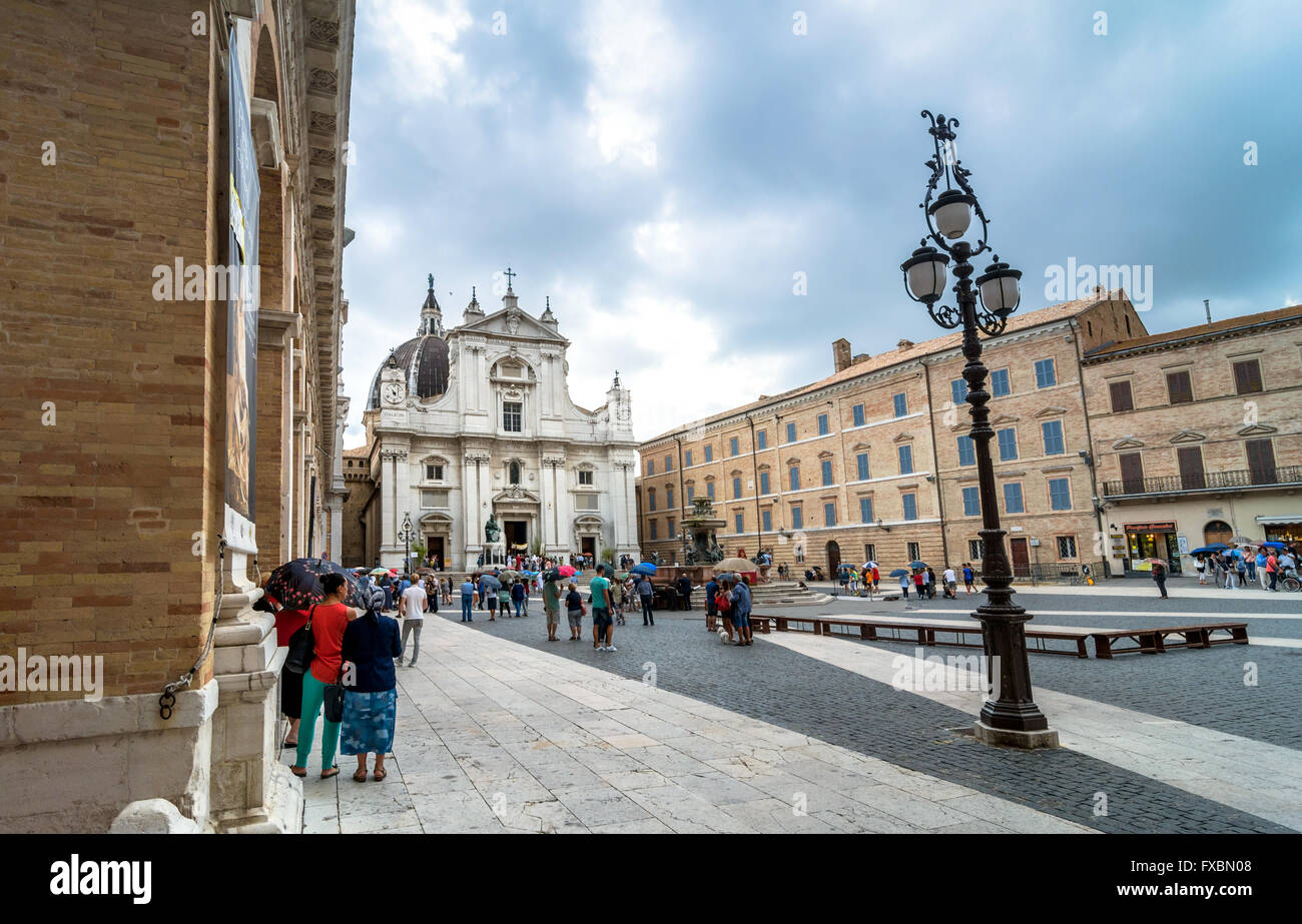 tourists and pilgrims in front of famous Shrine of the Holy House church in Loreto, Italy. - Stock Image