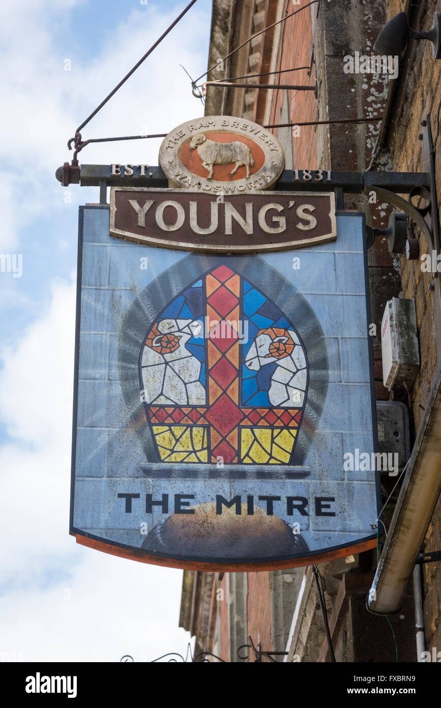 The pub sign at the Mitre public House in Shaftesbury Dorset UK, a Young's Brewery Inn - Stock Image