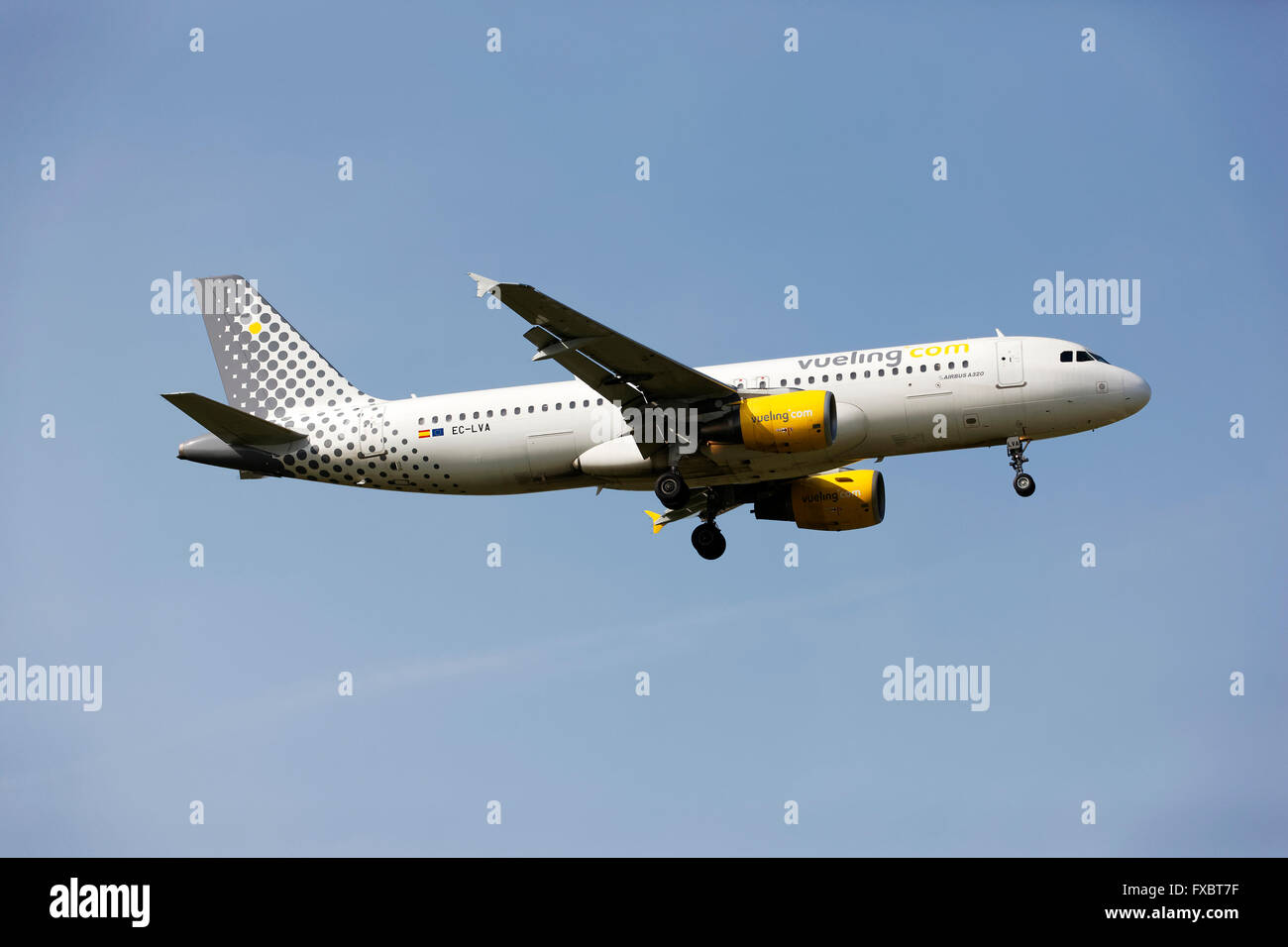 Vueling Airlines A320 Airbus on landing approach to  Franz Josef Strauss Airport, Munich, Upper Bavaria, Germany, - Stock Image