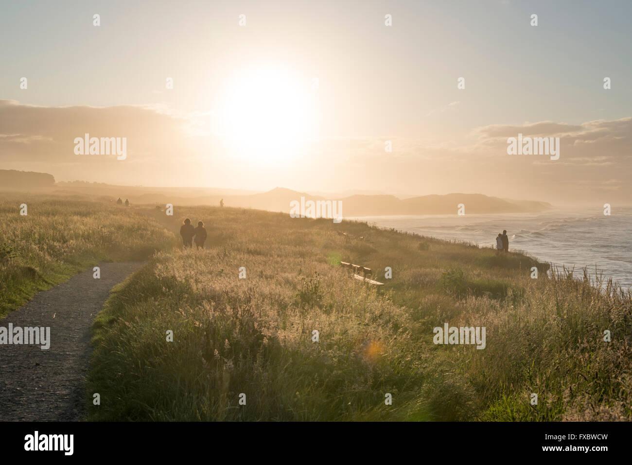 Walking along the cliffs at Seahouses, Northumberland - Stock Image