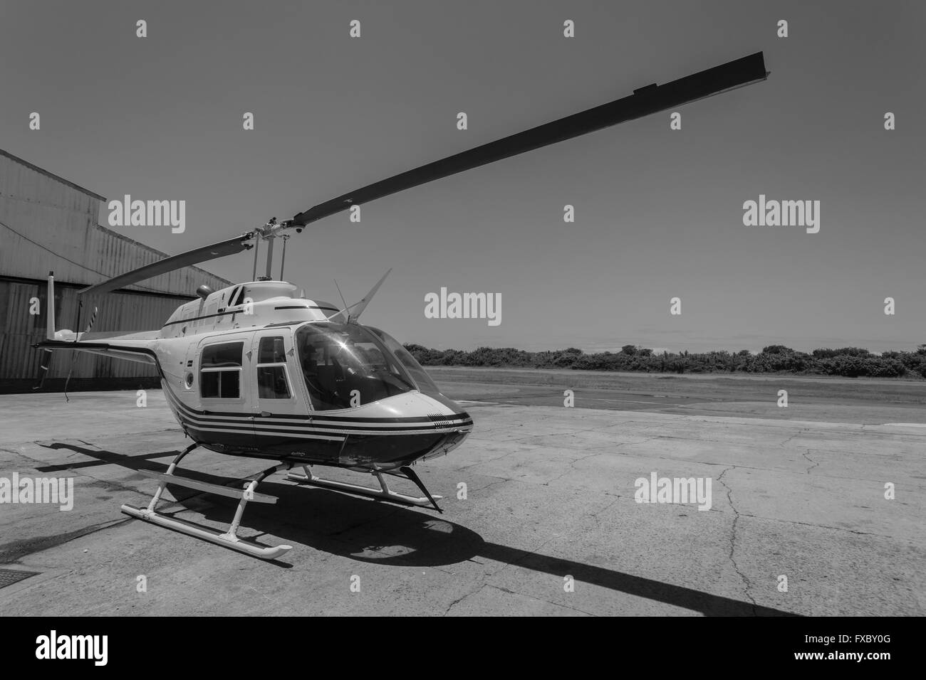 Helicopter aircraft on airport parked outdoors - Stock Image
