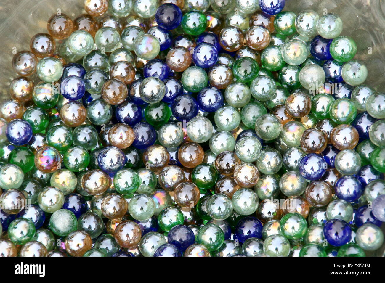 Assortment of colorful vintage playing marbles, flea market, Germany. - Stock Image