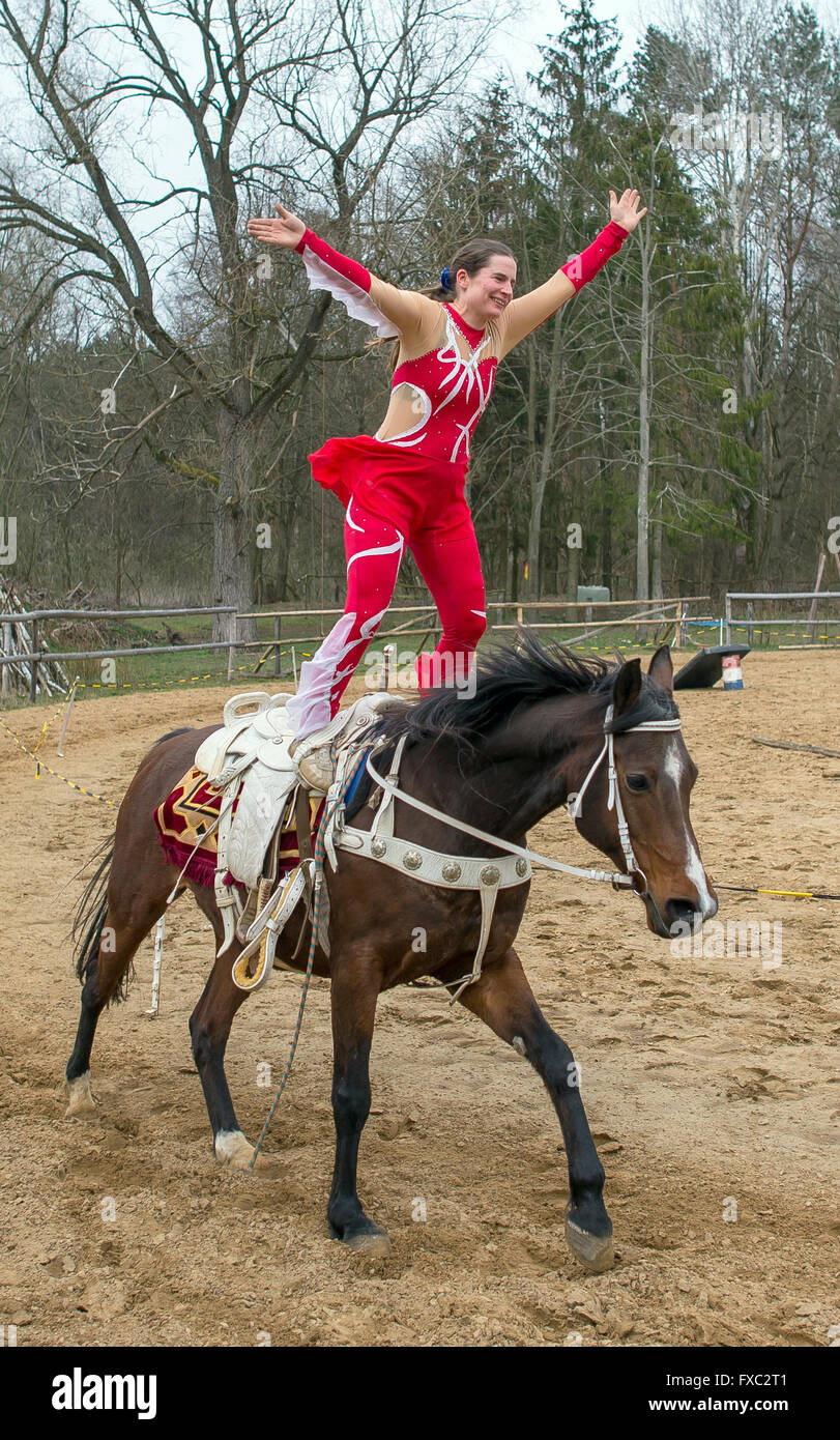 Muencheberg, Germany. 04th Apr, 2016. Stunt rider Daja Ziefuss rides her horse standing at Sunbow Ranch near Muencheberg, - Stock Image