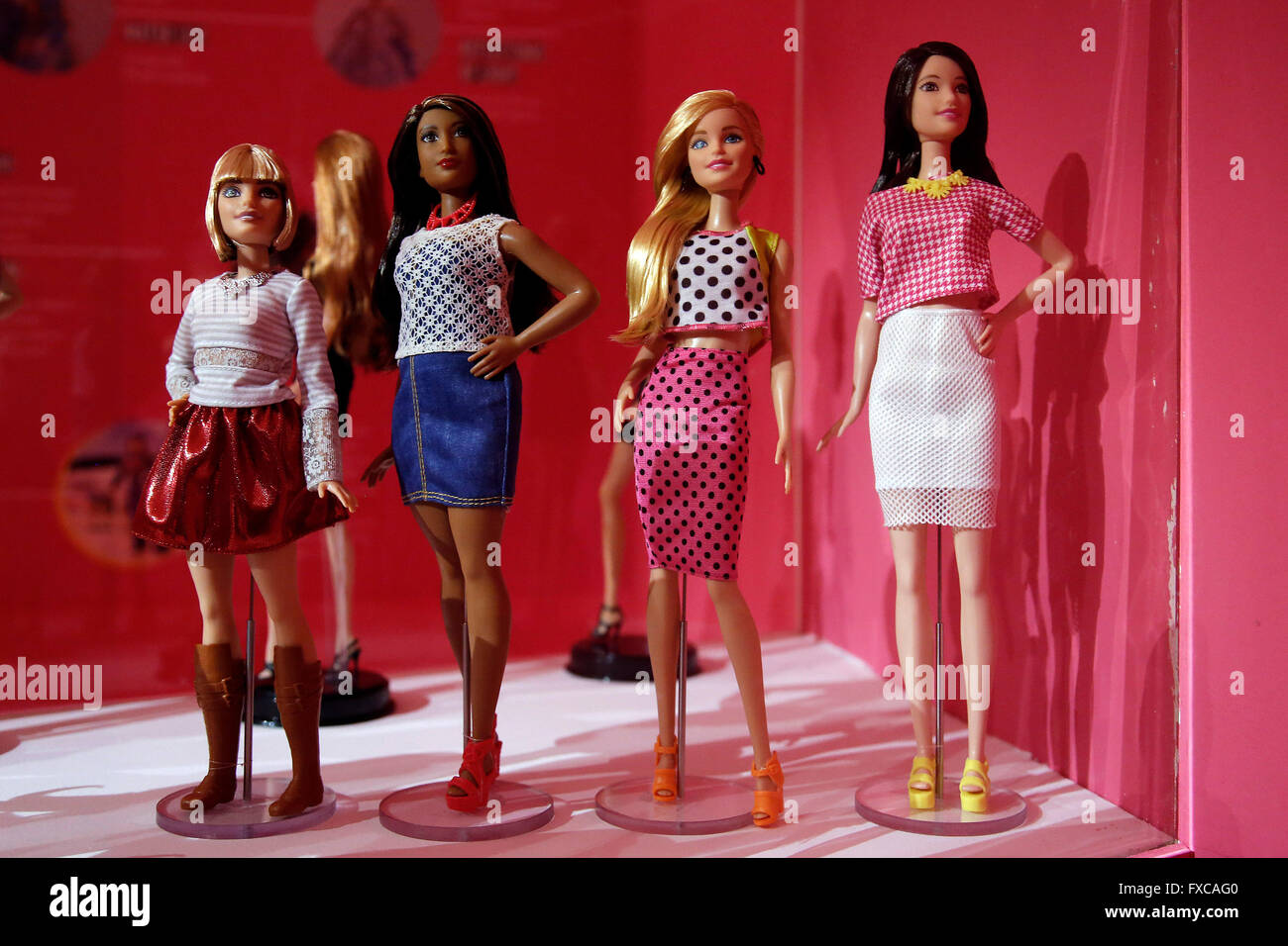 Rome, Italy. 14th April, 2016. Four 'politically correct' Barbies, a small one, an oversize, a 'normal' - Stock Image