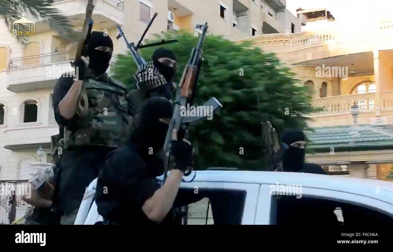 Undated propaganda video capture released by the Islamic State of Iraq and the Levant showing ISIS fighters riding - Stock Image