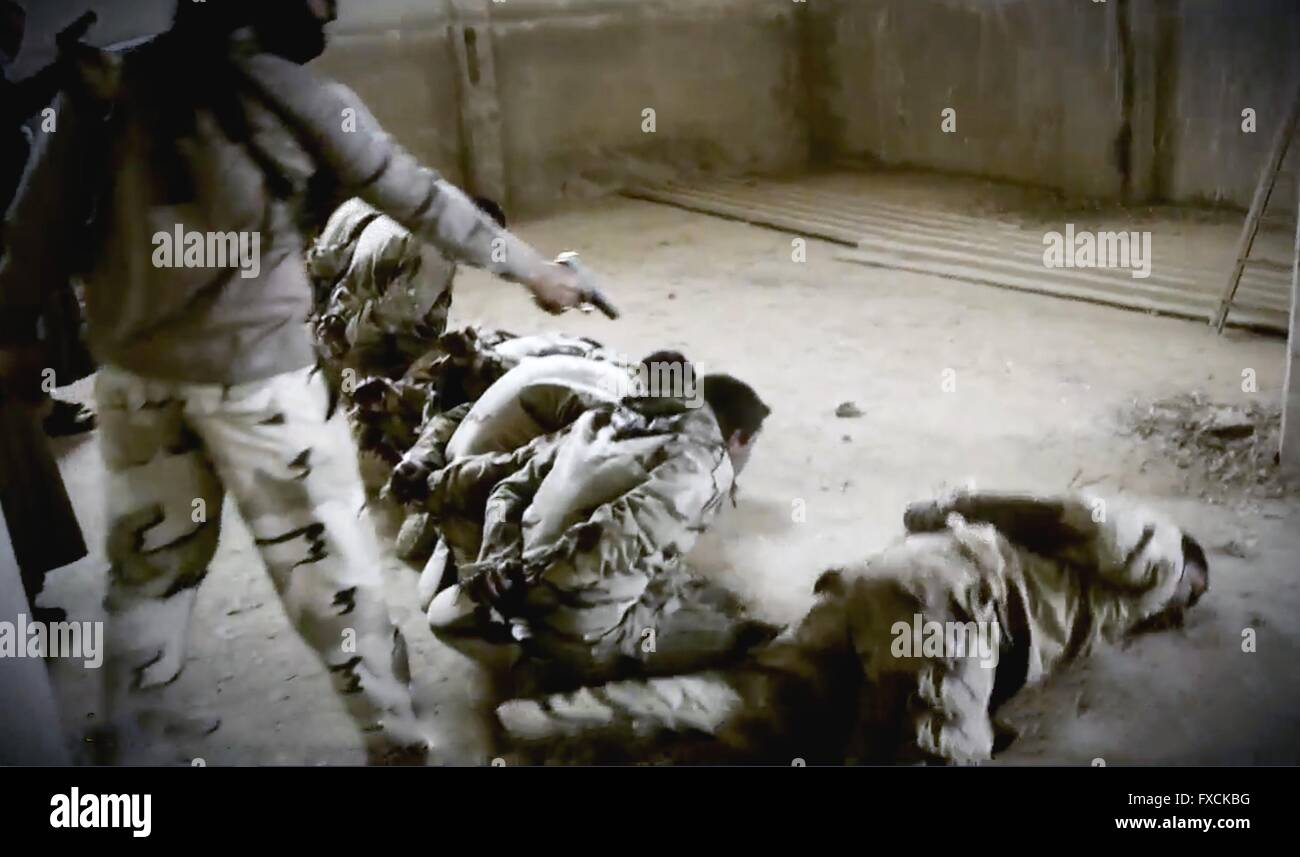 An Islamic State fighter executes Iraqi soldiers in this undated propaganda video capture released by the Islamic - Stock Image
