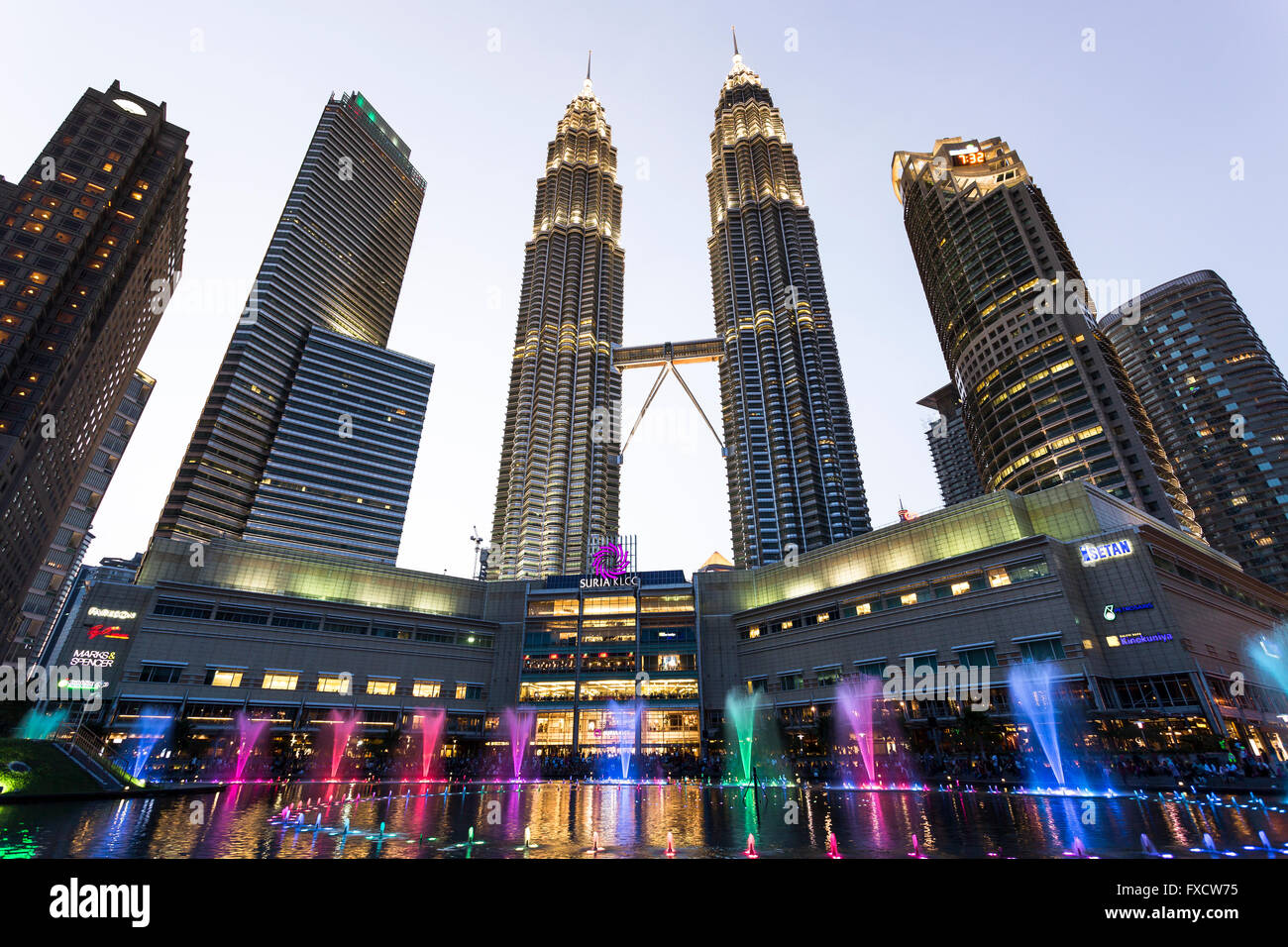 Kuala Lumpur, Malaysia - April: View of The Petronas Twin Towers and colorful water fountains - Stock Image