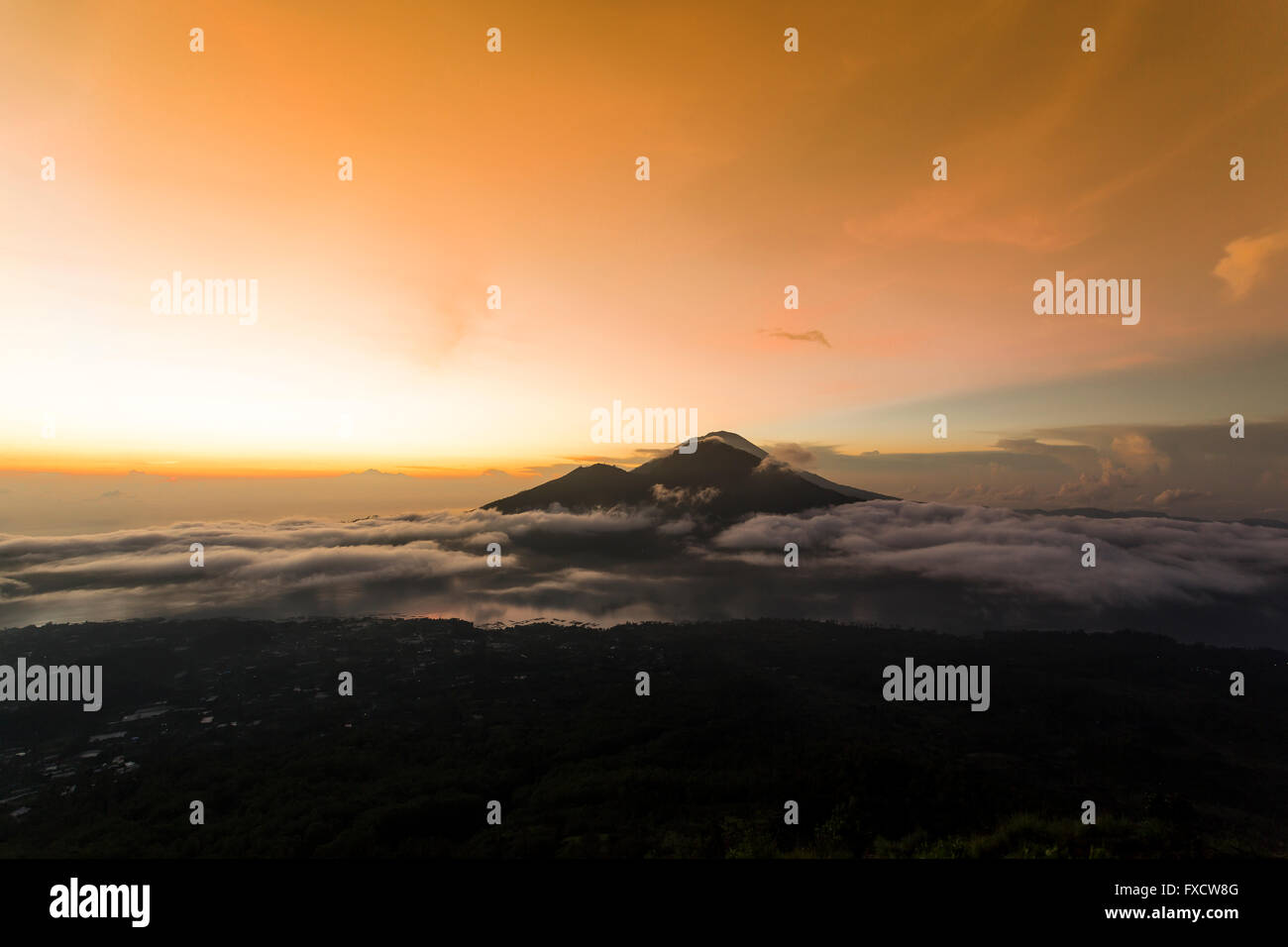 Sun rising on a beautiful morning from the top of Mount Batur - Bali, Indonesia - Stock Image