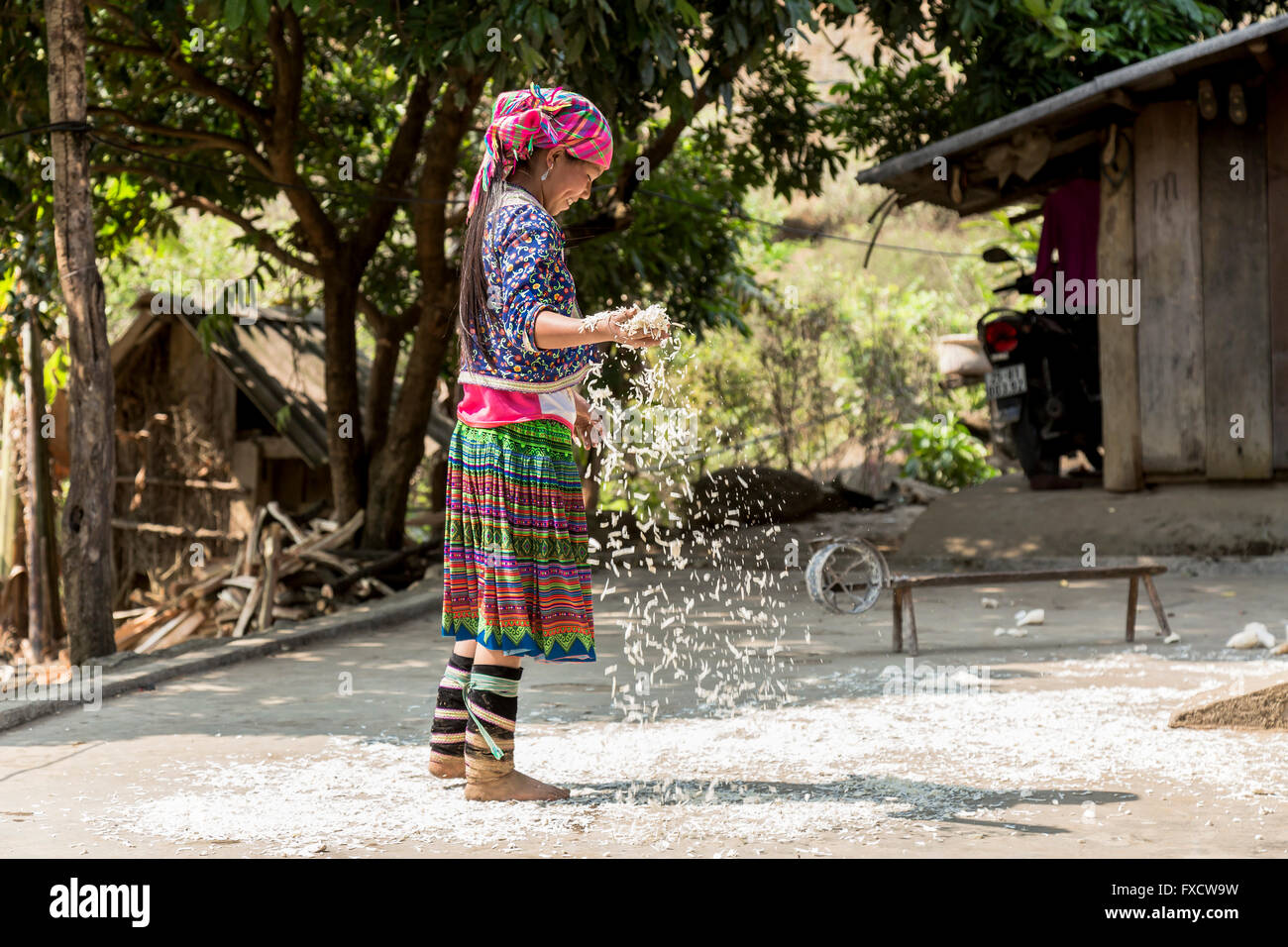 SaPa, Vietnam - March 2016. A girl from a minority village working in her house. - Stock Image