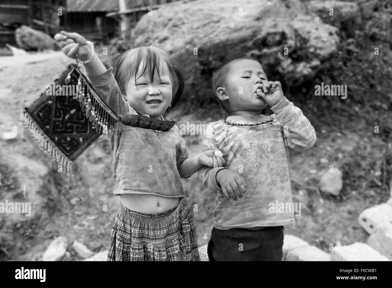 SaPa, Vietnam - March 2016 - Vietnamese kids from the villages around SaPa enjoying a piece of candy. Stock Photo