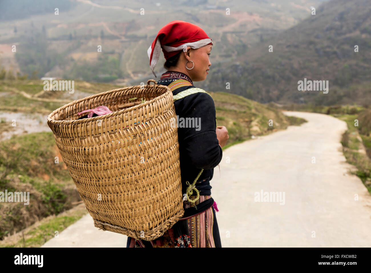 An ethnic minority woman carrying a basket in SaPa Vietnam - Stock Image