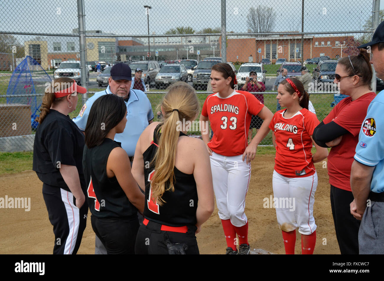 team captains, coaches and umpires greet each other at the beginning of a high school softball game in Annapolis, - Stock Image