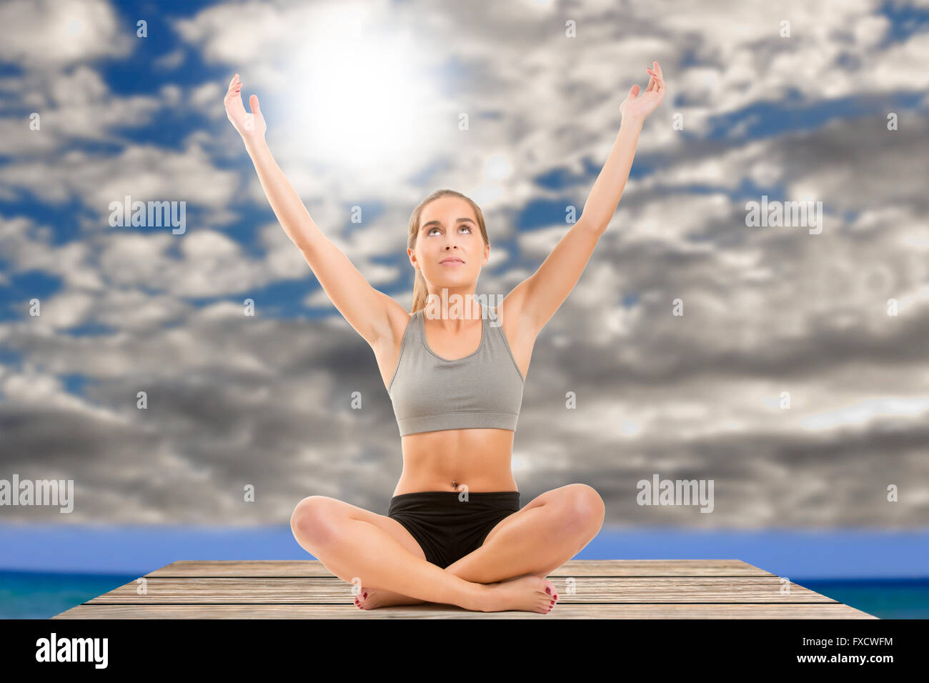 Woman sitting and looking to the sky. Concept of mindfulness - Stock Image