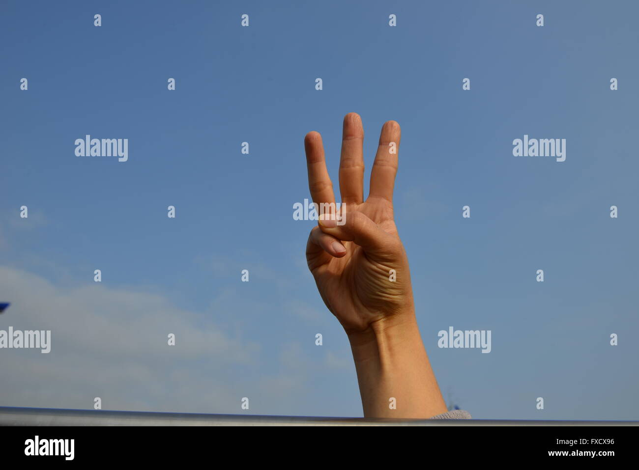 hand making the number three - Stock Image