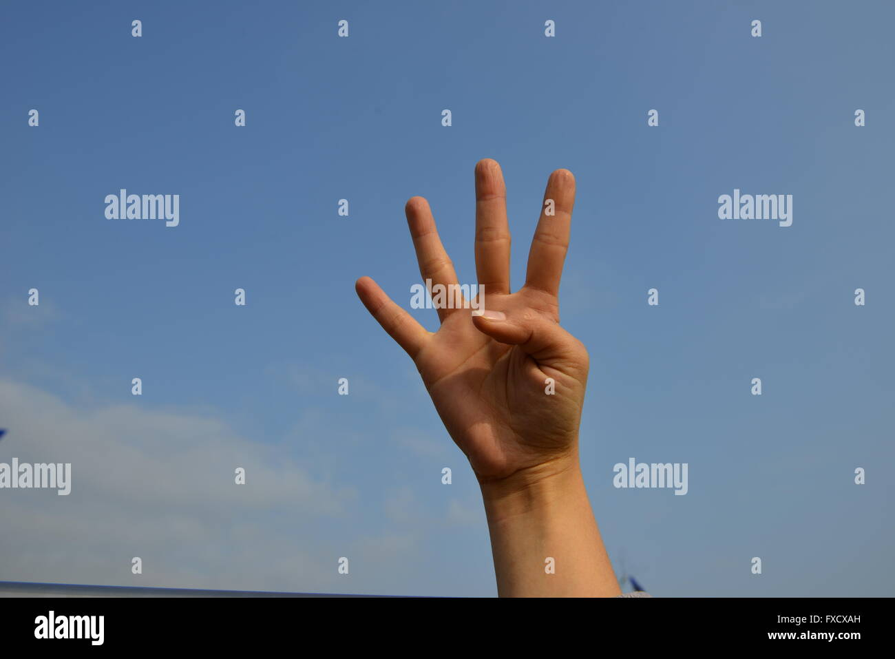 hand making the number four - Stock Image