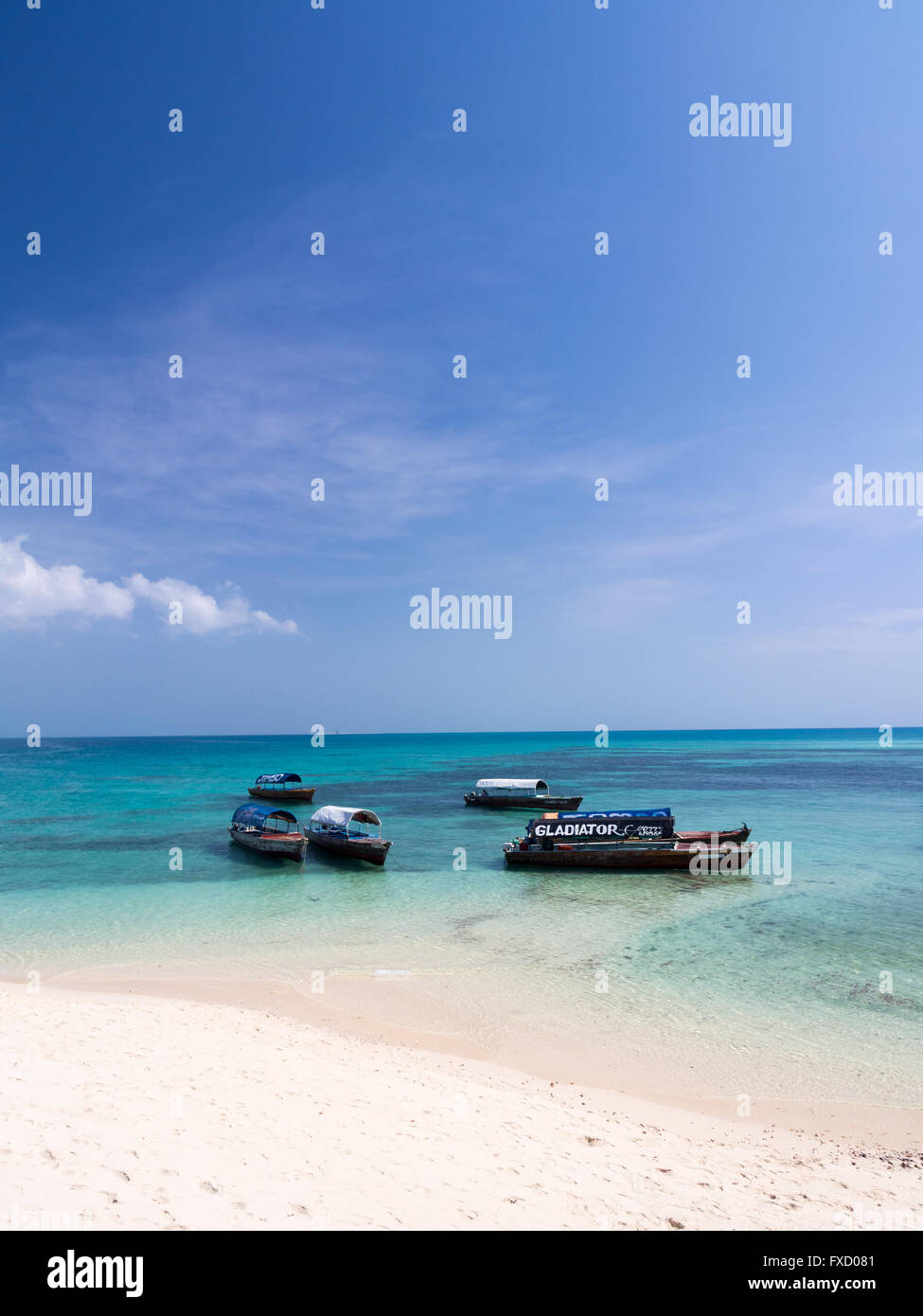 Local boats taking tourists to the Prison Island from Zanzibar. - Stock Image