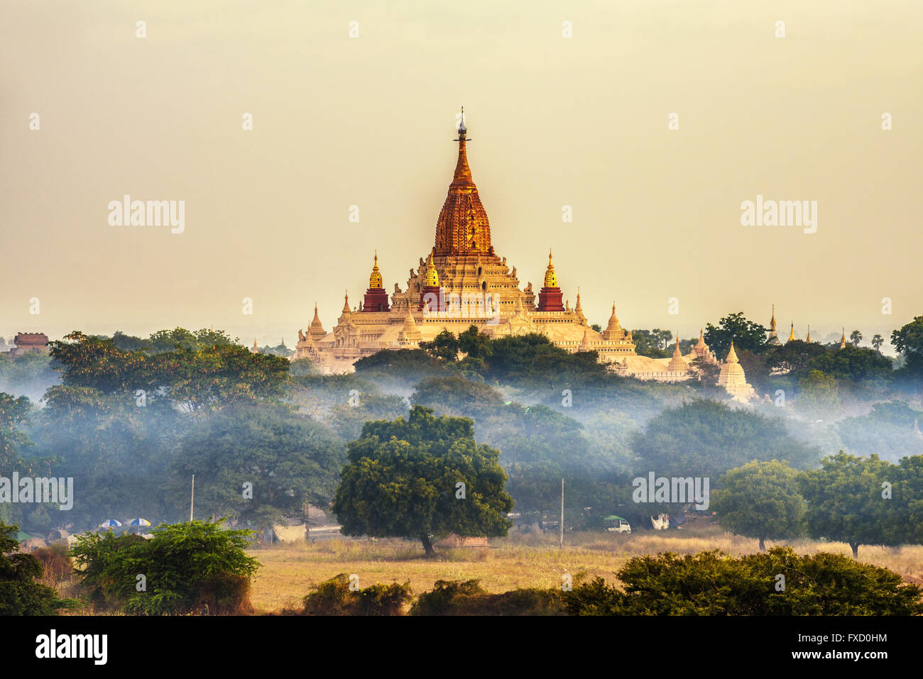 Ananda temple in Bagan at sunrise - Stock Image