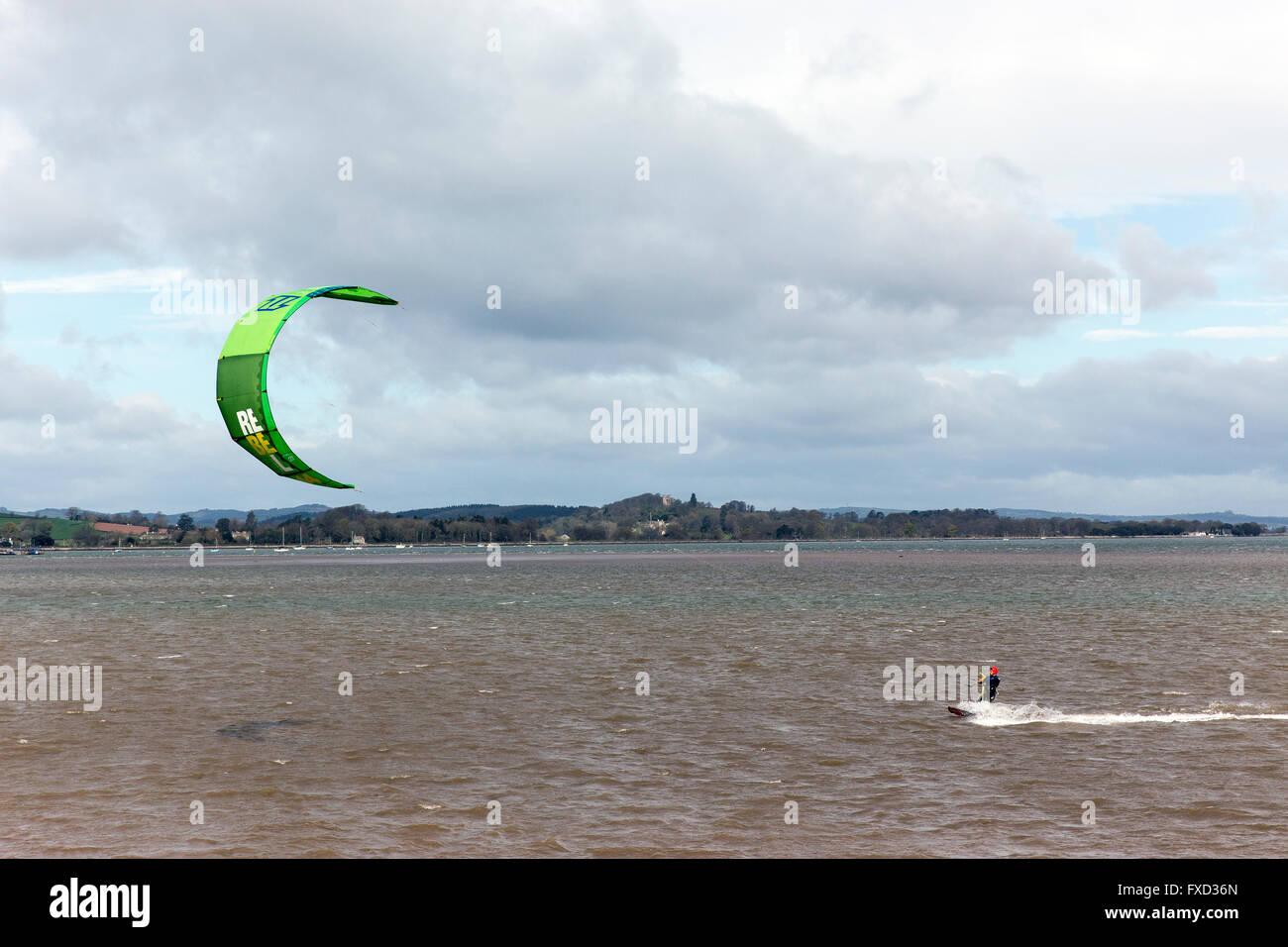 kite surfing in exmouth, river, exe, power, kitesurfer, beach, england, wind, sea, board, surf, devon, kitesurf, - Stock Image