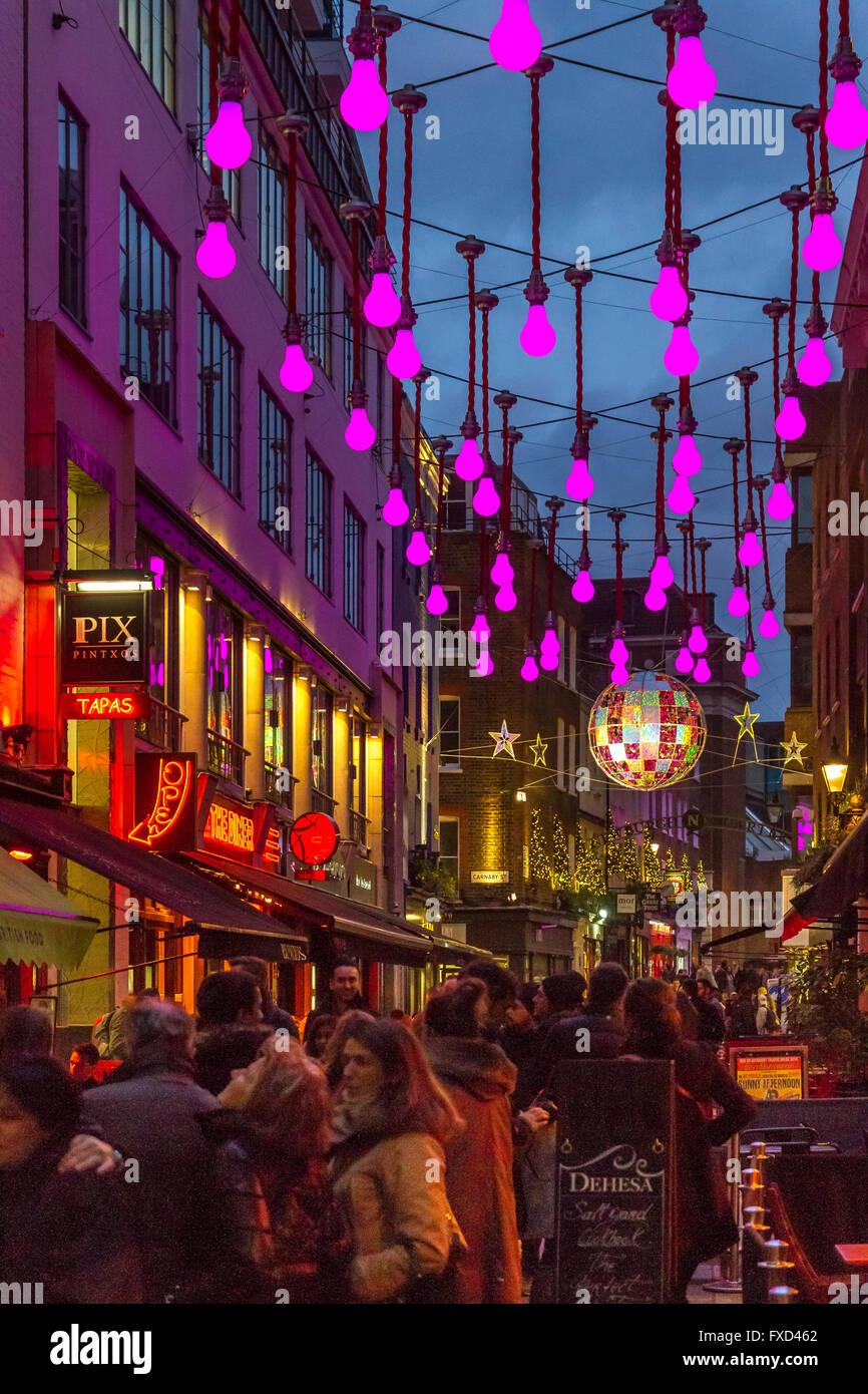 London Christmas Lights Festiv Giant Purple Light Bulbs Hanging Above Ganton St Soho London Uk