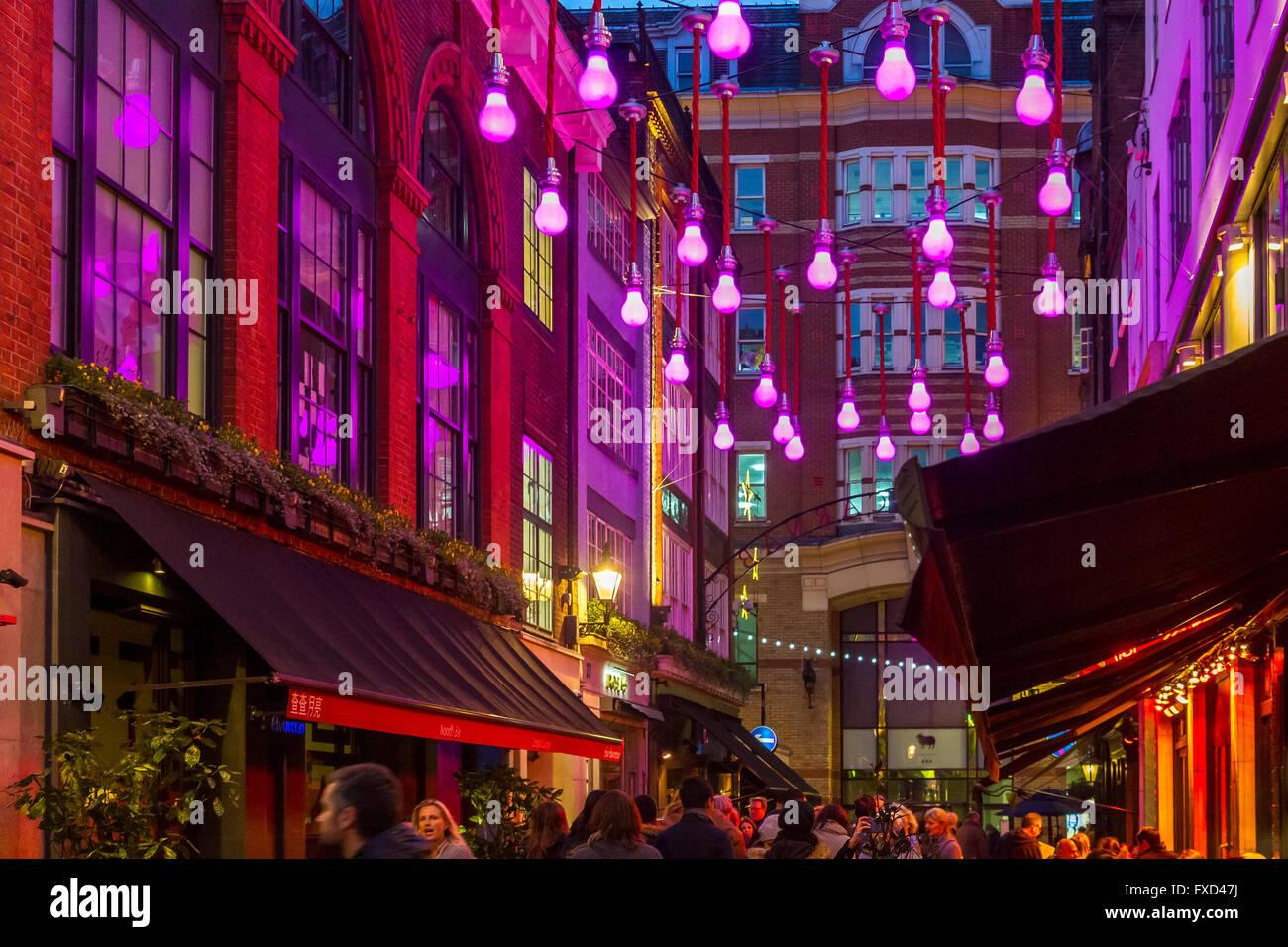 london christmas lights festiv giant purple light bulbs hanging
