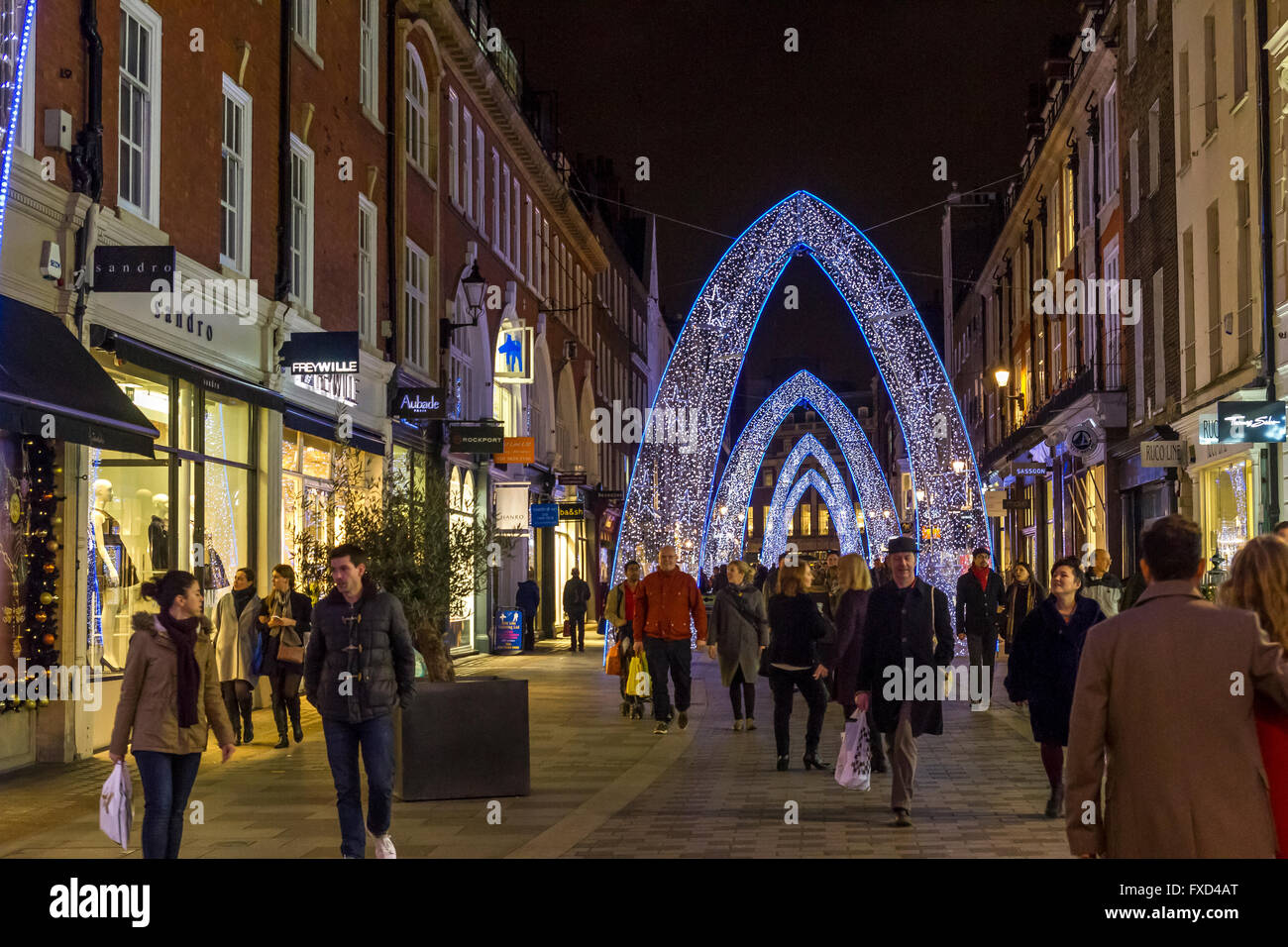 Christmas Lights  in London with an illuminated blue Arch on South Molton Street , London - Stock Image