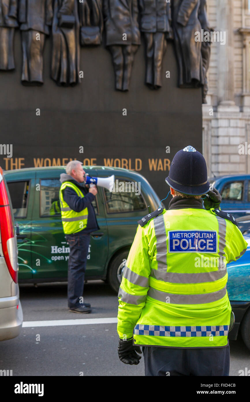 London Taxi Drivers Association Protest against Uber in London, hundred of Black London Taxis blockade Whitehall - Stock Image