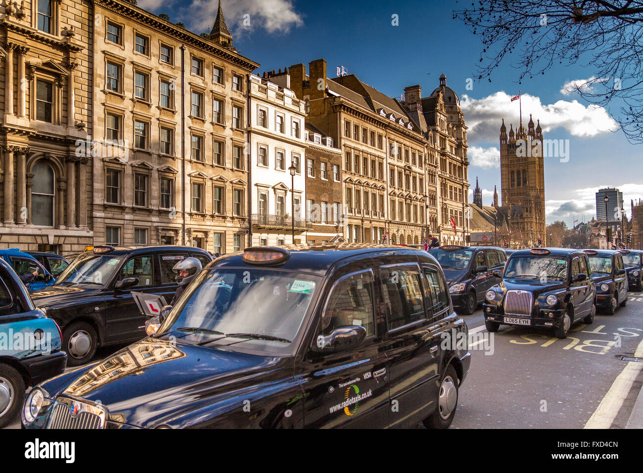 London Taxi Drivers Association Protest against Uber in London, hundred of Black London Taxis blockade Whitehall Stock Photo