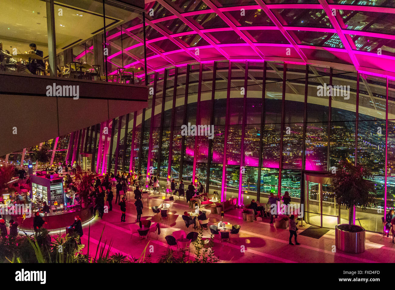 People enjoying drinks in the evening at The Sky Pod Bar ,The Sky Garden, 20 Fenchurch St, also known as the Walkie - Stock Image